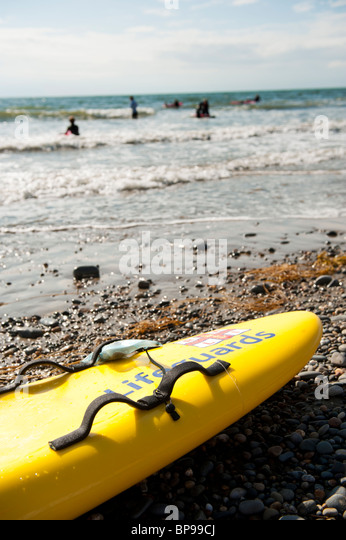 RNLI lifeguard training session, Aberystwyth beach, Wales UK - Stock Image