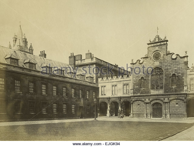 Circa 1870 Albumen Print of Peterhouse College at Cambridge University, England. Shows two men standing and one - Stock Image
