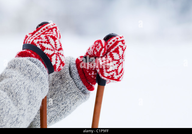 Person holding ski poles - Stock-Bilder