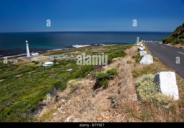 Slangkop point lighthouse on the Atlantic coast of the Cape Peninsula near Cape Town in South Africa. - Stock Image