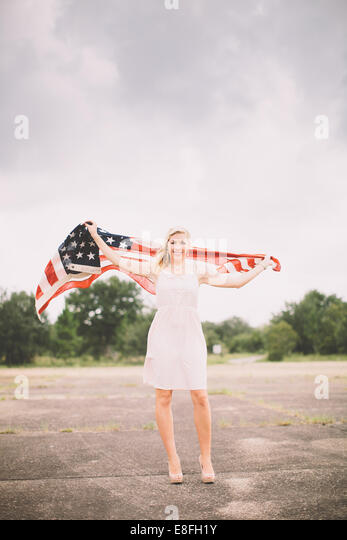 USA, Florida, Okaloosa County, Fort Walton Beach, Portrait of girl with american flag - Stock-Bilder