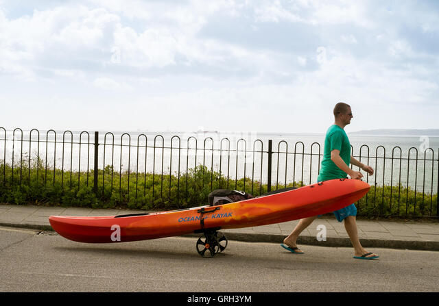 Falmouth, UK. 8th September, 2016. Man pulling his kayak on a trailer to Gyllyngvase Beach, Falmouth Credit:  Mick - Stock Image