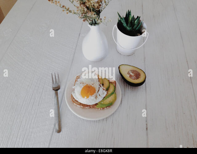 Aerial view of avocado and fried egg - Stock-Bilder