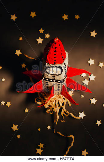 Business startup and launching still-life on a spaceship firing rocket boosters into an expansion of growth and - Stock Image