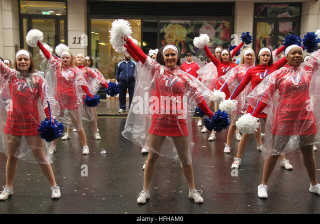 London, UK. 1st January 2017. Cheerleaders wearing waterproof ponchos seen during rehearsals ahead of the annual - Stock Image
