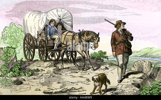 Pioneer family moving west in a covered wagon 1840s - Stock Image