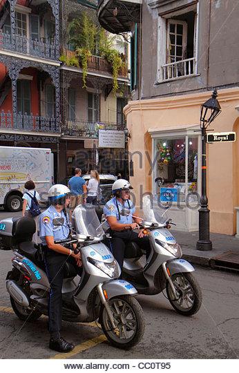 Louisiana New Orleans French Quarter Royal Street street scene NOPD police policeman officer job man motorcycle - Stock Image