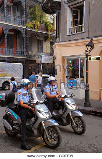New Orleans Louisiana French Quarter Royal Street street scene NOPD police policeman officer job man motorcycle - Stock Image