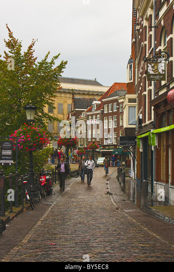 Utrecht, Netherlands city street with people walking; gray overcast day - Stock Image