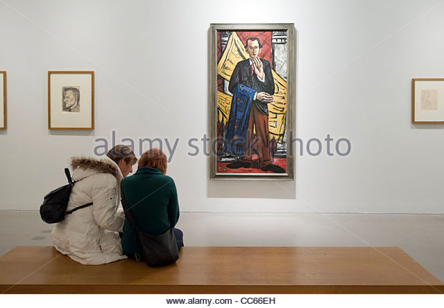Two women sitting on a bench in front of a painting by Max Beckmann, Museum der bildenden Kunste, Leipzig, Saxony, - Stock Image