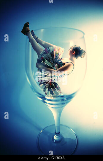 Girl in glass fashion photoshoot - Stock Image