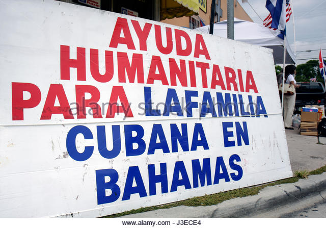 Miami Florida Little Havana Calle Ocho banner activist human rights organization humanitarian aid Cubans Bahamas - Stock Image
