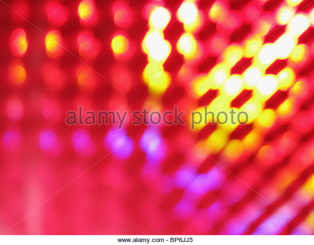 An abstract image of purple, pink and yellow lights - Stock-Bilder