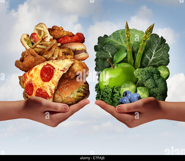 Nutrition choice and diet decision concept and eating choices dilemma between healthy good fresh fruit and vegetables - Stock Image