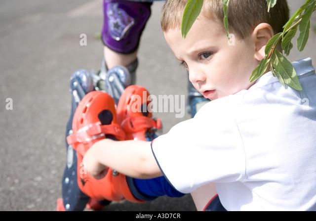 Young boy on rollerblades - Stock-Bilder