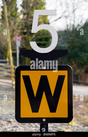 Speed restriction and whistle sign on the Welsh Highland Railway, Nantmor, Snowdonia, North Wales, UK - Stock Image