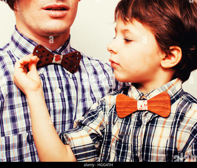 father with son in bowties on white background, casual look - Stock Image