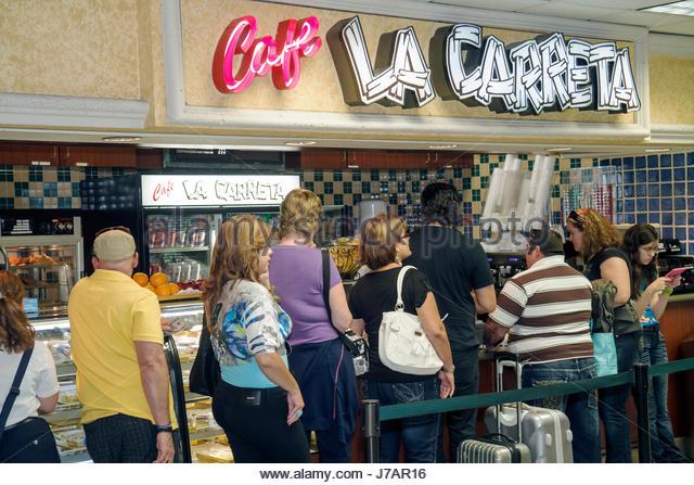 Miami Florida Miami International Airport MIA Cafe La Carreta line queue fast food service - Stock Image