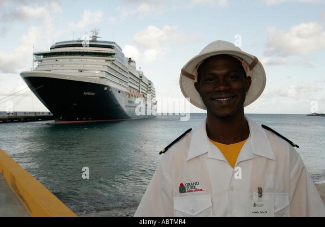 Grand Turk Cockburn Town Holland America Line ms Noordam port Black male security guard - Stock Image