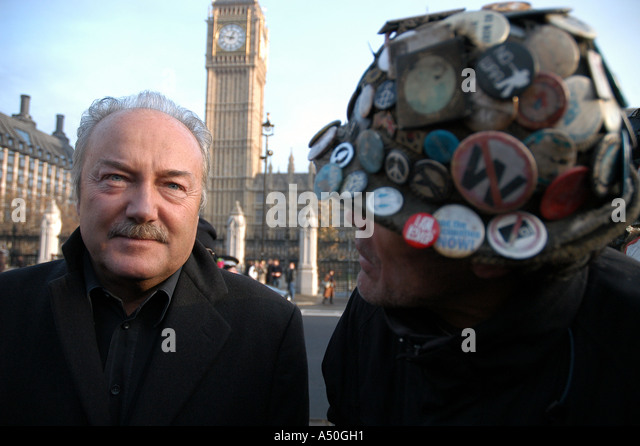 Respect MP George Galloway (L) pays a visit to Brian Haw, the permanent peace protestor of Parliament Square, London. - Stock Image