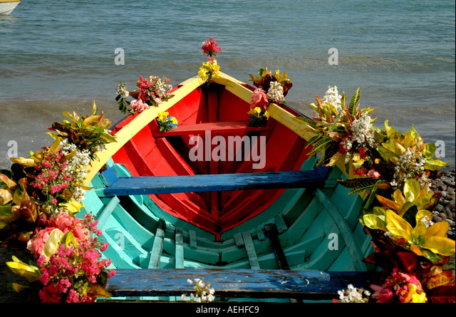 Grenada caribbean religious festival Colorful Boat Decked with Flowers St. Peter's June birthday - Stock Image