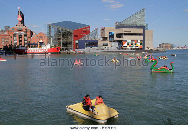 Baltimore Maryland Inner Harbor Patapsco River port waterfront Harborplace attraction National Aquarium paddle boat - Stock Image