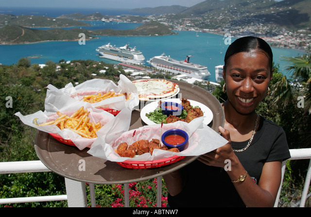 St. Thomas USVI Paradise Point Black female waitress food Charlotte Amalie Harbor Caribbean Sea cruise ships - Stock Image