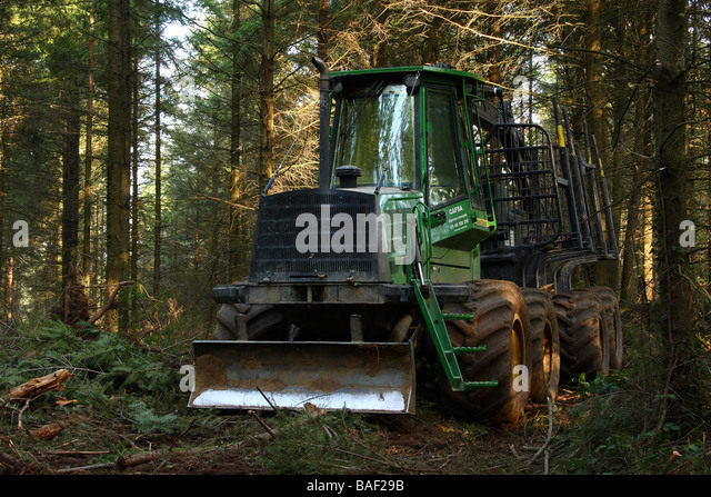 A John Deere logging machine in woodland Limousin France - Stock Image