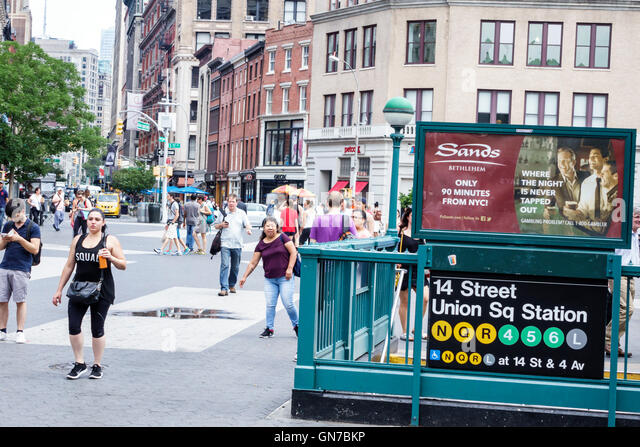 Manhattan New York City NYC NY Union Square street scene Asian Hispanic woman pedestrian walking building 14th Street - Stock Image