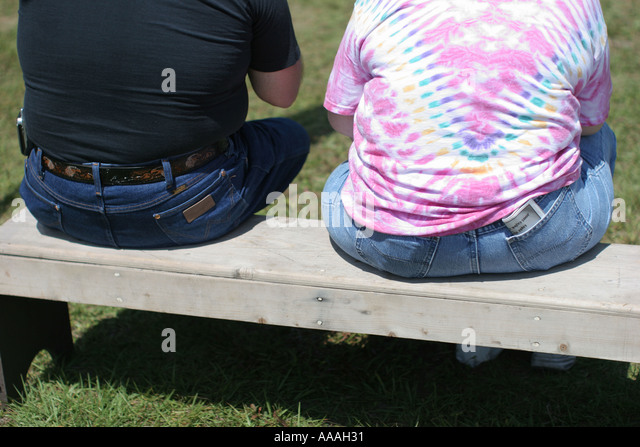 Florida, overweight couple, sitting, bench, diet, eating, exercise, health, weight, calories, - Stock Image
