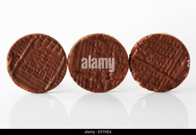 Chocolate covered Rice cakes in a row - Stock Image