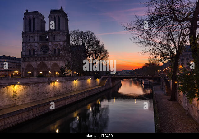 Notre Dame de Paris cathedral at sunrise with the Seine River. Ile de La Cite. 4th Arrondissement, Paris, France - Stock Image