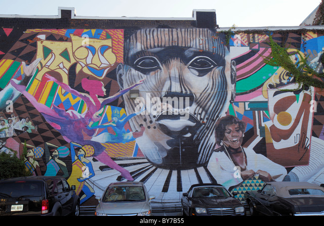 Atlanta Georgia Edgewood Avenue building wall mural African American arts dance theatre music heritage face mask - Stock Image