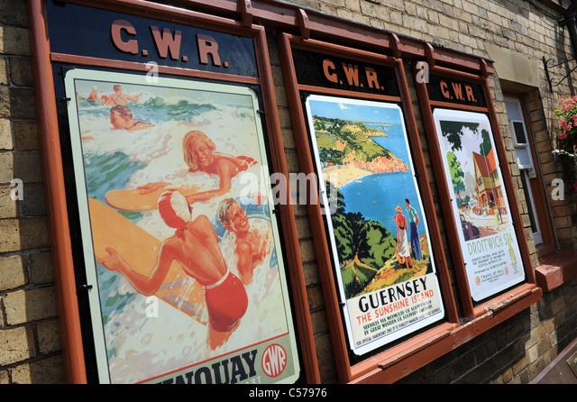 Old railway holiday travel posters on Severn Valley Railway Uk - Stock-Bilder