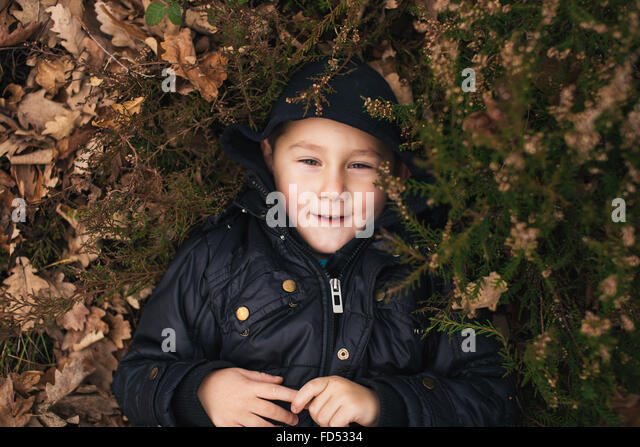 Little kid enjoying time in nature - Stock Image