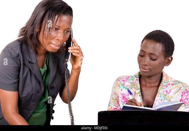 Young businesswoman uses the phone from her college to call customers. - Stock Image