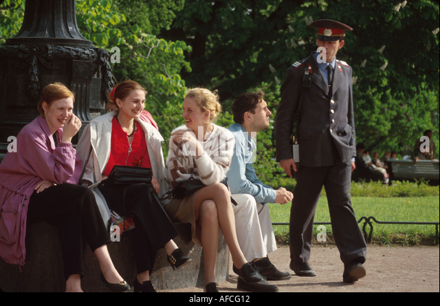 Russia former Soviet Union St. Petersburg Catherine's Garden city park residents policeman - Stock Image