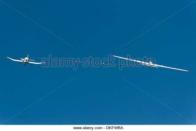 Glider being towed into the sky - Stock Image