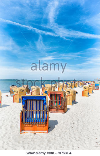 Row covered beach chairs nostalgic summer seat - Stock Image