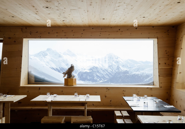 Panoramic window with mountain scenery at the Corviglia Club, St Moritz - Stock Image
