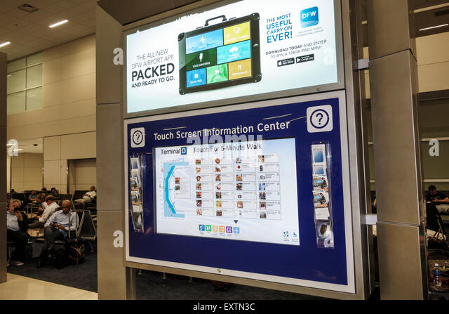 Dallas Texas Dallas Ft. Fort Worth International Airport DFW American Airlines terminal concourse touch screen information - Stock Image