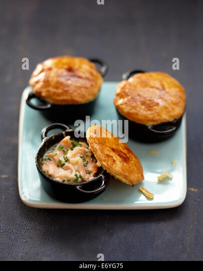 Smoked salmon casseroles sealed with pastry - Stock Image