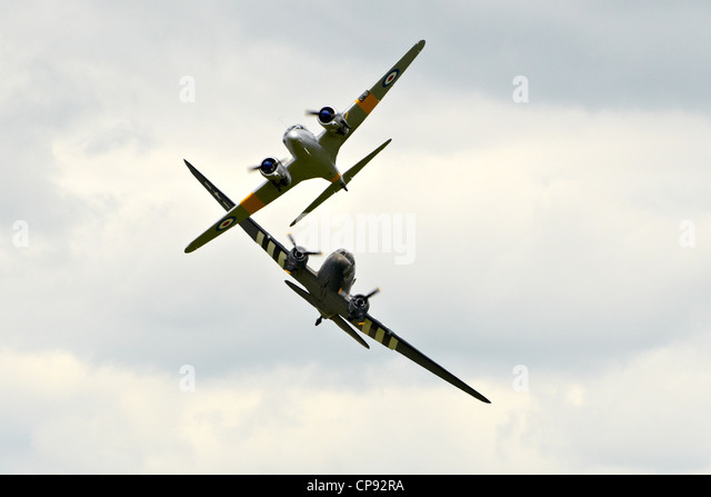 Douglas DC3 Dakota  (C-47 Skytrain) from D-Day in WW2 at Abingdon Airshow 2012 displaying with an Avro Anson - Stock Image
