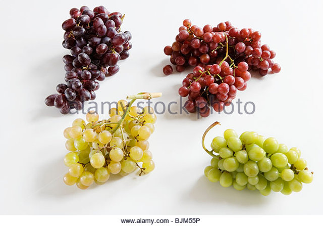 Four Bunches of Assorted Grapes on a White Background - Stock Image