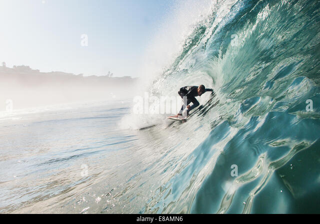 Mid adult man surfing rolling wave, Leucadia, California, USA - Stock Image