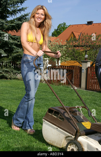 Woman with lawnmower - Stock Image