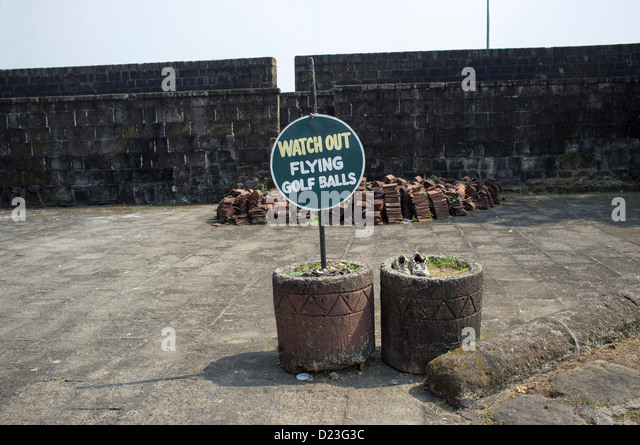 Watch Out Flying Golf Balls Sign Intramuros manila - Stock Image