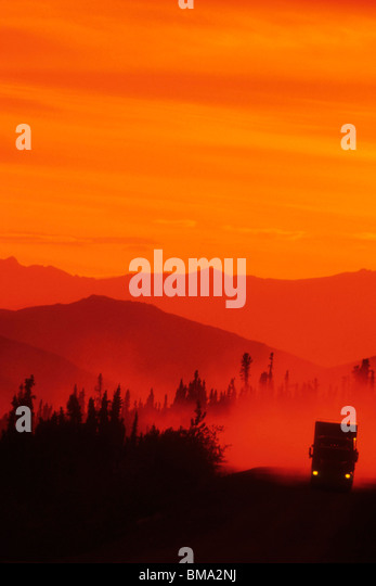 Truck on a lonely road. - Stock Image