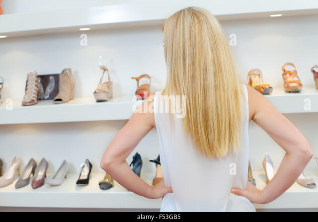 Choosing a new pair of shoes - Stock Image