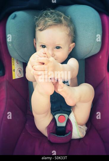 Baby in car seat - Stock Image